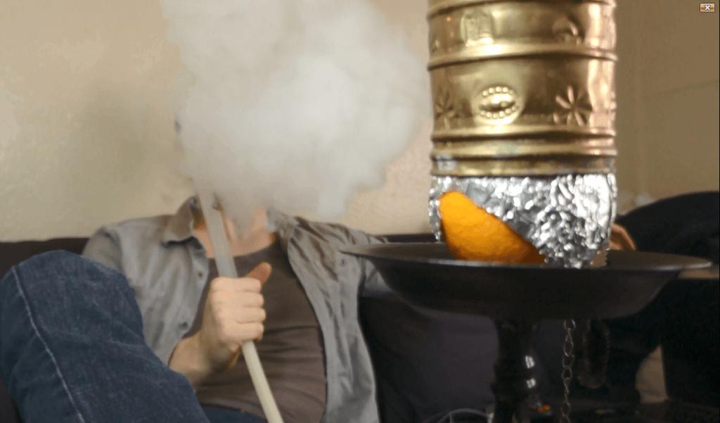 Smoking an Orange Hookah Bowl